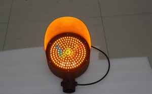 Yellow warning traffic signal light